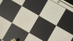 Black pawn wins chess match Stock Footage
