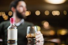 Small liquor bottle on table Stock Photos