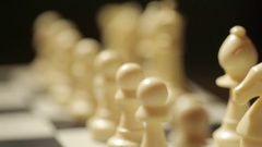 Chess white pieces in shifting focus Stock Footage
