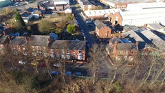 Aerial view of a row of terraced house in the UK. Stock Footage