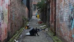 Looking down an inner-city garbage strewn alleyway Stock Footage