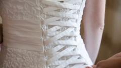 Bridesmaids tightened corset wedding dress Stock Footage