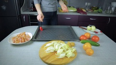 Girl chef preparing raw chicken meat on baking sheet Stock Footage