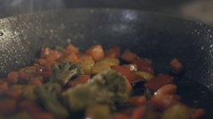 Chef in a kitchen making flambe with vegetables Stock Footage