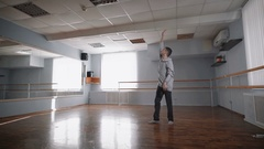 The professional dancer rehearses. He is in the hall for rehearsals. Rehearses Stock Footage