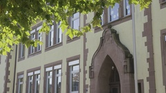 Old school building with green leaves Stock Footage