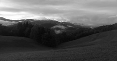 Sun and clouds on the sky above small hills at evening Stock Footage