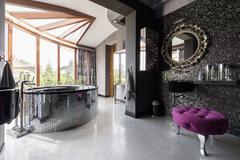 Posh bathroom with oval bath Stock Photos