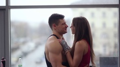 Young couple express love to each other. Sporty man and woman in love hug and Stock Footage