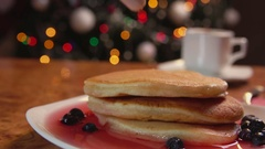 Confectionery syringe puts cream in stack of pancakes Stock Footage