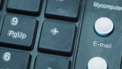 Email. Close-up of an e-mail envelope icon on a computer keyboard button Stock Footage