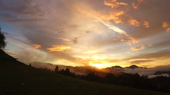 Intensive colors of sunset and clouds on the summer evening Stock Footage
