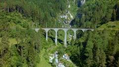 Alpine trains. Mountain bridge. Viaduct. Summer. Aerial view Stock Footage