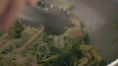 Chef is cooking seaweed salad, close up Stock Footage