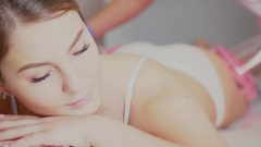 Woman lying on the couch with closed eyes in the vacuum-roller massage Stock Footage