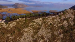 Flying over the fortress, Lake Skadar and Balkan mountains in Montenegro Stock Footage