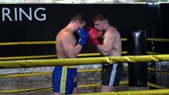 Boxer duck defense knockout to head punch opponent falls HD slow motion video Stock Footage