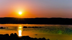 4k.Red  sunrise time over lake or seacoast . Timelapse  without birds.  Stock Footage