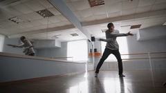 Man learns to dance. Dancer makes a jump in dance. Sensual dance of a lone man Stock Footage
