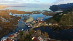 Flying over the lake and the old town Virpazar, Skadar Lake in Montenegro Stock Footage