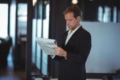 Businessman reading a financial report Stock Photos