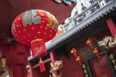 Chinese lanterns at a temple in Chinatown at night Stock Photos