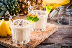 Pineapple smoothie with banana, chia seeds and mint Stock Photos