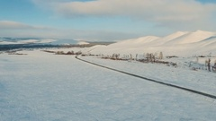 Road by the snow field at the dusk. Stock Footage