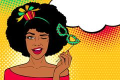 Afro american woman with gift on her head and carnival mask smiles and winks Stock Illustration