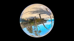 Beautiful Tropical Landscape seen through a Glass Orb, on black, loop Stock Footage