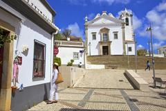 Shopping with The Neo-Classical Igreja Matriz de Estoi Church in the background Stock Photos
