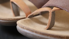 Fashion quality sandals example of craftsmanship close-up slow tilt Stock Footage