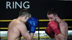 Boxer making hook punch, knockout opponent falls down HD slow motion video Stock Footage