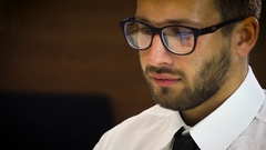 Young male businessman in a white shirt and glasses Stock Footage