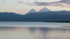 Volcanic cones behind lake Stock Footage