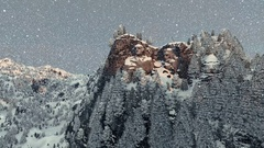 Mount Rushmore in winter, snowing, camera fly Stock Footage