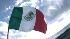 Mexican Flag Waving on Beach in Slow Motion Stock Footage