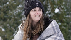 Girls playing with snowballs in the park Stock Footage