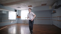 Beautiful dance of hip-hop dancer. Boy with a serious face rehearses his dance Arkistovideo