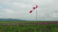 Empty helipad with weather vane in tundra Stock Footage