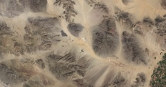 High-altitude overflight aerial of rocky, arid land in California's Mojave Deser Stock Footage