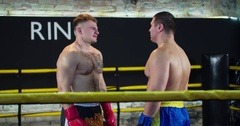 Two boxers face-off looks each other fight 4k video ring  Chest muscles plays Stock Footage