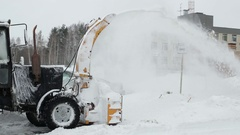 Tractor snow blower after a snowstorm. laterally Stock Footage