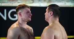 Two boxers face-off looks each other before fight 4k video boxing ring close-up Stock Footage