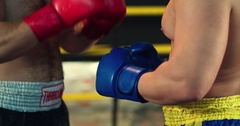 Two boxers start fight touch gloves each other 4k video in boxing ring Stock Footage