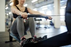 Rowing in gym Stock Photos