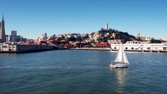 Sailboat crosses water by San Francisco skyline 8 Stock Footage