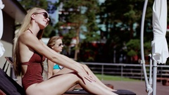 Attractive young girls taking sun bath Stock Footage