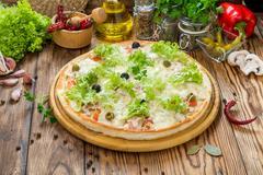 Delicious italia pizza in a restaurant Stock Photos