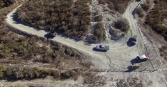 Aerial Shot of Trucks Turning a Corner Stock Footage